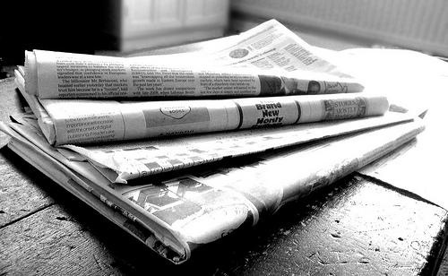 black and white picture of newspapers
